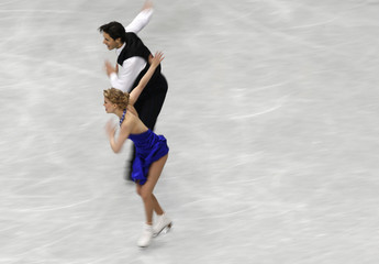 Canada's Kaitlyn Weaver and Andrew Poje compete during the ice dance short dance program at the ISU World Figure Skating Championships in Saitama