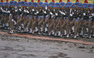 India's CRPF personnel take part in a passing out parade amid a drizzle in Humhama, on the outskirts of Srinagar