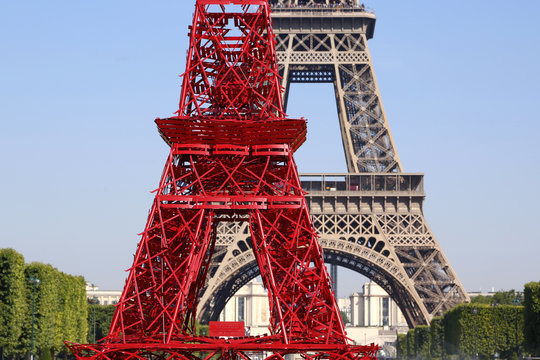 Details of red bistro chairs that make up a replica of the Eiffel Tower to mark the 125th anniversary of the Fermob company's bistro chairs in Paris