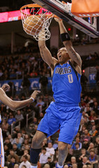 Mavericks' Shawn Marion scores on a dunk in the first period as the Thunder play the Mavericks during pre-season NBA basketball action in Oklahoma City