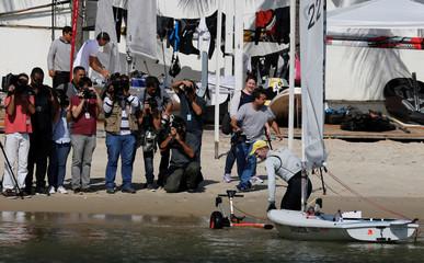 Brazilian Olympic team sailor Robert Scheidt prepares his laser yacht before a training session in Rio de Janeiro
