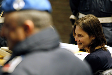 Knox, the U.S. student convicted of killing her British flatmate in Italy three years ago, smiles as she sits in the courtroom before a trial session in Perugia