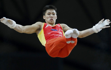 Zhang Chenglong of China competes on the horizontal bar during the men's final round of the Doha Gymnastics World Cup at the Aspire Academy in Qatar