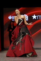 Monica presents a creation during the American Heart Association's (AHA) Go Red For Women Red Dress Collection, presented by Macy's at New York Fashion Week.