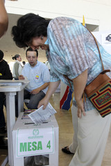 A woman casts her vote during presidential elections in Bogota