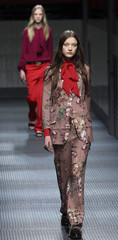 A model displays a creation as part of the Gucci Autumn/Winter 2015 /16 collection during Milan Fashion Week