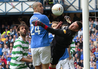 Rangers' goalkeeper McGregor(R) saves the ball off trhe line from a header by Celtic's Majstorovic(not in pic) during their Scottish Premier League 'Old Firm' soccer match in Glasgow, Scotland