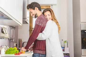 Beatiful couple cooking vegetables in the kitchen at home