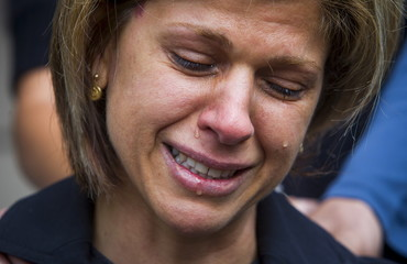 Tima Kurdi cries while speaking to the media outside her home in Coquitlam, B.C.