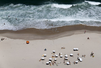 Residents and tourists relax at Copacabana beach in Rio de Janeiro