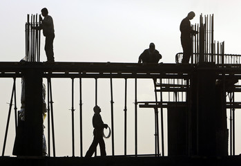 Afghan men work at a construction site in Kabul