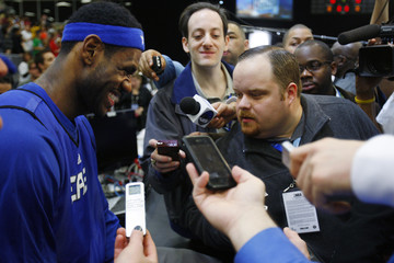 East All-Star James of the Cleveland Cavaliers reacts to a question during the All-Star media availability in Dallas