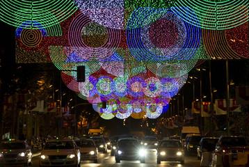 Christmas lights illuminate a central street in Madrid