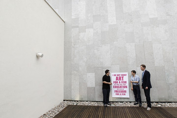 Artist pose with a placard during a media launch at the Royal Festival Hall in London