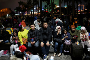 Revellers take part in New Year's Eve celebrations in Hong Kong