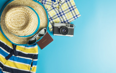 Summer Travel Fashion for boys on blue copy space