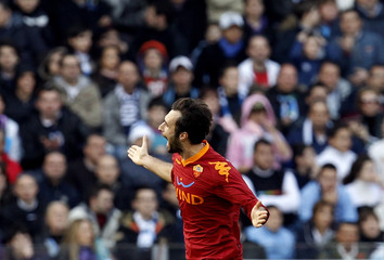 AS Roma's Vucinic celebrates after scoring against Napoli during their Italian Serie A soccer match in Naples