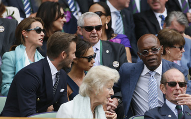 David and Victoria Beckham and actor Samuel L Jackson sit on Centre Court at the Wimbledon Tennis Championships, in London