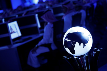 Data collectors sit at screens in new the Global Center for Combatting Extremist Ideology as they wait for a tour by Trump and Saudi Arabia's King Salman to commence in Riyadh