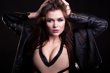 Hot woman with big breast on black background in studio photo. Sexy and beauty. Fashion and seductive
