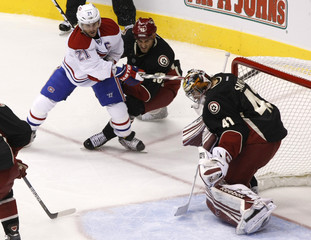 Montreal Canadiens right wing Gionta scores on Phoenix Coyotes goaltender Smith in the second period during an NHL game in Glendale