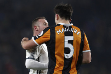Manchester United's Wayne Rooney and Hull City's Harry Maguire after the match