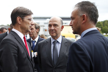 French Finance Minister Moscovici and Public Investment Bank managing director Dufourcq arrive to attend the inauguration of the BPI Franche-Comte regional branch in Besancon