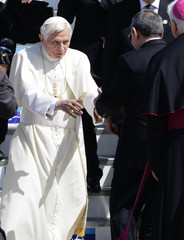 Pope Benedict XVI greets Cuba's President Raul Castro after his arrival in Santiago de Cuba