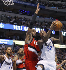 Mavericks' Stevenson goes up for the shot against Blazers' Aldridge during Game 2 of their NBA Western Conference playoff series in Dallas