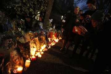 People view tributes to singer George Michael outside of his home in north London