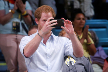 Britain's Prince Harry takes a photo with his smartphone at the Invictus Games in Orlando, Florida, U.S.