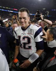 New England Patriots' quarterback Tom Brady smiles after his team defeated the Atlanta Falcons at Super Bowl LI in Houston