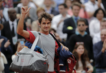 Roger Federer of Switzerland leaves the court after being defeated by Ernests Gulbis of Latvia in their men's singles match at the French Open tennis tournament at the Roland Garros stadium in Paris