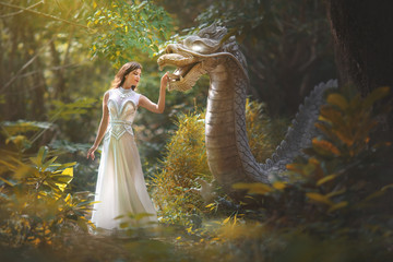 Fairy tale of a girl with a dragon in the forest