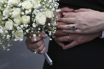 Newlywed Bride and Groom Holding Hands
