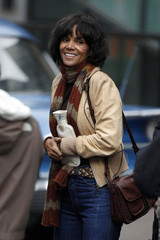 Actress Halle Berry smiles as she holds a hot water bottle between takes during filming of 'Cloud Atlas' in Glasgow, Scotland