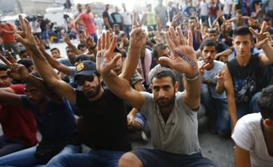 Migrants protest outside the Keleti railway station in Budapest