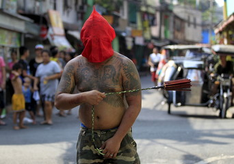 A flagellant whips his back during Maundy Thursday Lenten rites in Mandaluyong city