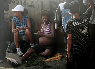 File photo of a pregnant woman smoking crack in the part of Sao Paulo's Luz neighborhood known as Cracolandia (Crackland)