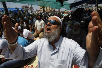 Supporters of Sunni Muslim Salafist leader Ahmad al-Assir attend Friday prayers at a sit-in in Sidon, southern Lebanon