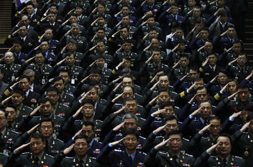 South Korean military personnel salute to new defence minister Kim Kwan-jin during his inauguration ceremony in Seoul
