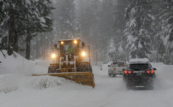 Snow is cleared from a residential road during a winter storm in Incline Village, Nevada