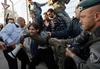 A left-wing Israeli activist is arrested by police during a protest against Jewish settlement activity in Arab East Jerusalem