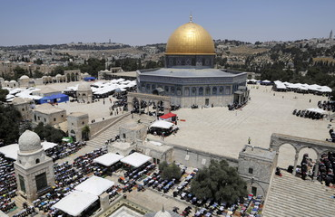 A general view shows Palestinians praying near the Dome of the Rock on the third Friday of Ramadan in Jerusalem's Old City