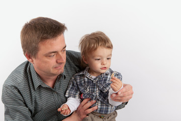 Hearing aids in the Family - Father showing his hearing aids to his small son.