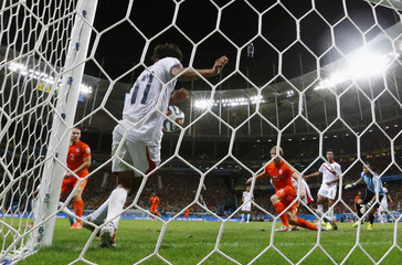 Costa Rica's Tejeda blocks a goal attempt from the Netherlands during their 2014 World Cup quarter-finals at the Fonte Nova arena in Salvador