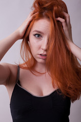 Gorgeous Sexy Busty Redhead Woman In Studio Photo On Gray Background Sexuality And Sensuality