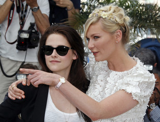 Cast members Stewart and Dunst pose during a photocall for the film On The Road at the 65th Cannes Film Festival