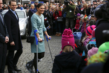 Sweden's Crown Princess Victoria makes her way on crutches to her fans as she and her husband Prince Daniel, the Duke of Vastergotland, arrive at the town hall in Duesseldorf