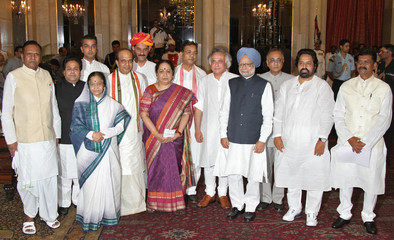 Newly appointed Indian ministers pose for pictures at the presidential palace in New Delhi